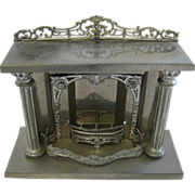 Antique doll house miniature heavy tin French fireplace with columns Au Nain Blue Paris