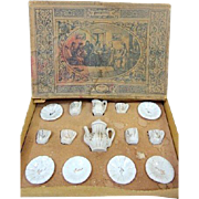 Very small miniature German white & gold antique doll tea service in the original box