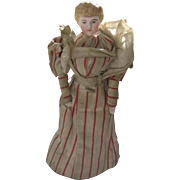 """5 3/4 """" German antique bisque head doll Hairstyle has a bun at the back"""