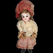 Antique French girl mignonette in original clothes