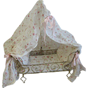 Antique French white metal canopy bed with pink floral fabric