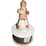 Antique Heubach bisque cotton girl with muff on snowball candy container box