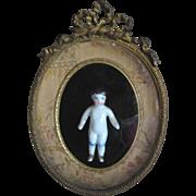Antique framed small Frozen Charlotte