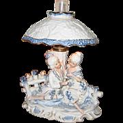 Antique porcelain cobalt blue & white Romantic figurine lamp