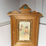 Decorated Antique miniature doll house armoire