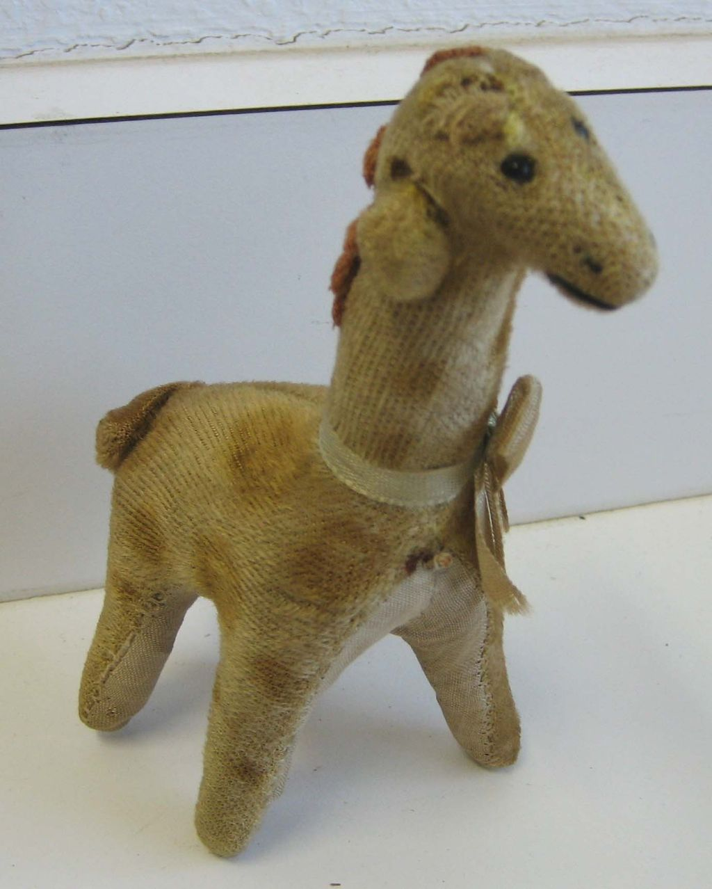 Antique toy animal Giraffe
