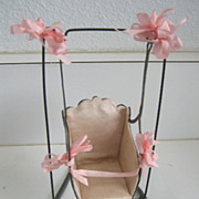 Antique French miniature metal baby doll swing with pink silk liner