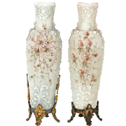 Pair of Wavecrest vases with a raised design.