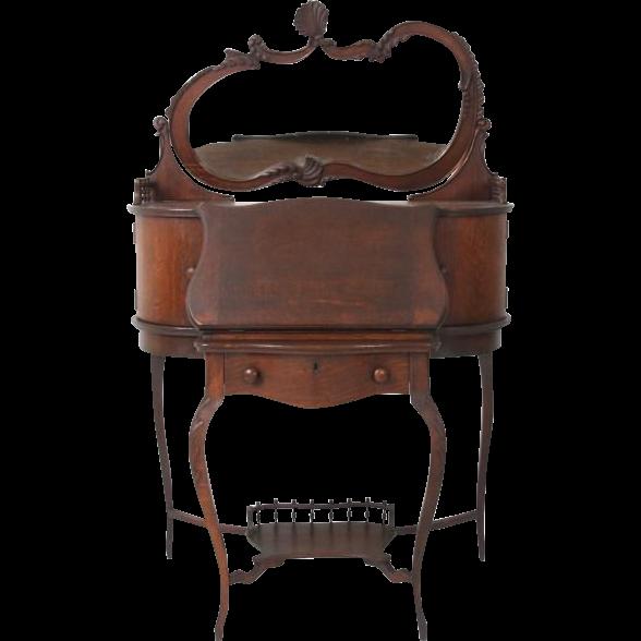 Oak ladies secretary desk with fancy shaped mirror on back