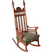 Oak rocking chair with corn and face carvings