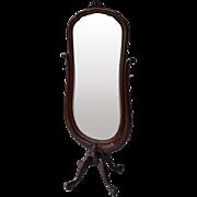 Mahogany cheval mirror with shaped beveled glass