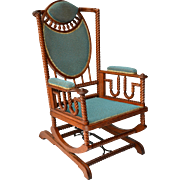 Victorian oak platform rocker made by George Hunzinger