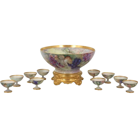 Eleven piece TV Limoge hand painted punch set with fruit motif
