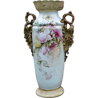 Large Victorian porcelain vase with painted floral decoration
