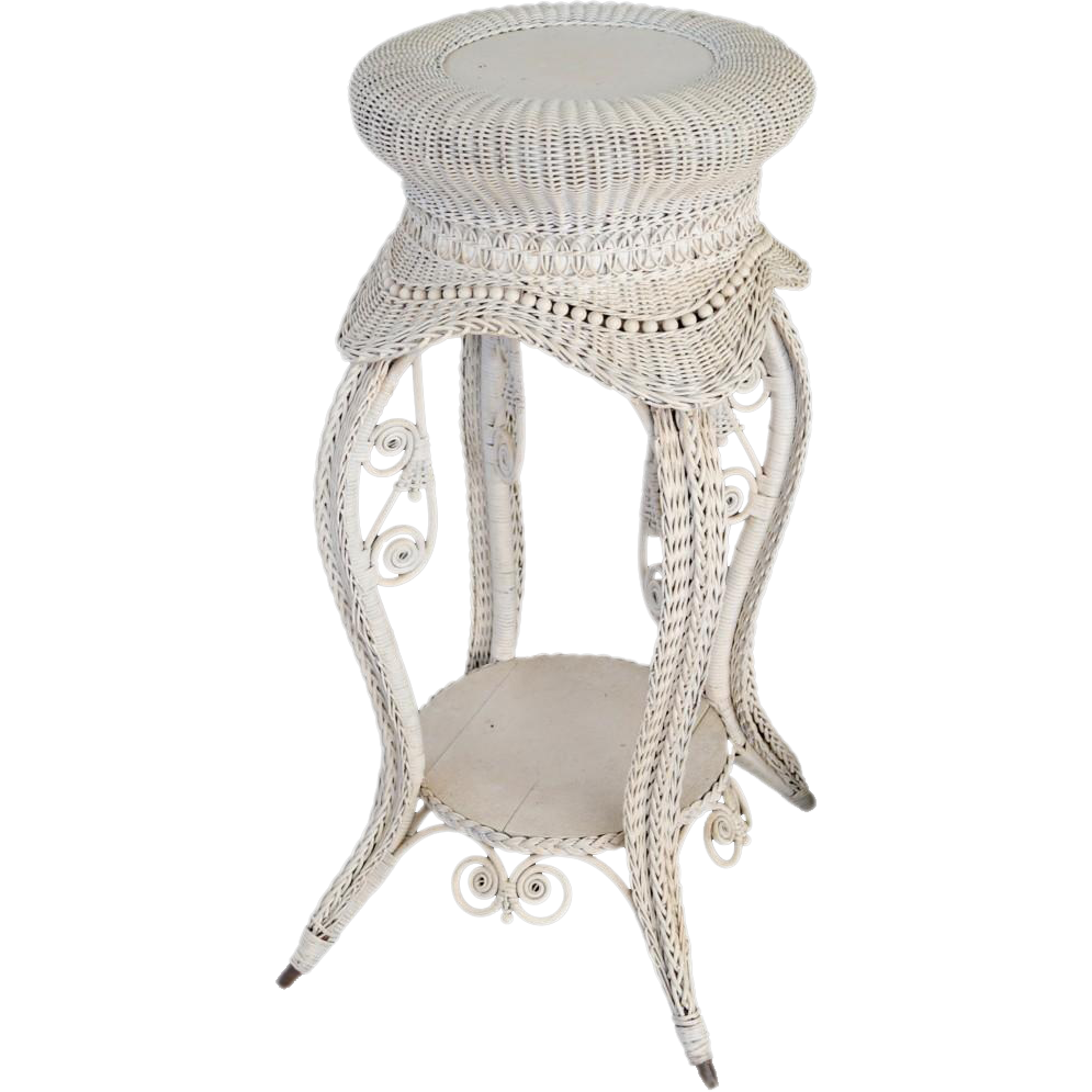 Victorian round wicker pedestal with fancy woven legs