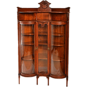 Serpentine Front Double Door Oak China Closet with Fancy Spindled Gallery