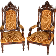 Pair of Carved Walnut Victorian Armchairs with Knights and Griffins