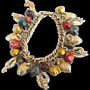 Lucite Bead & Gold Tone Acorn Charm Bracelet