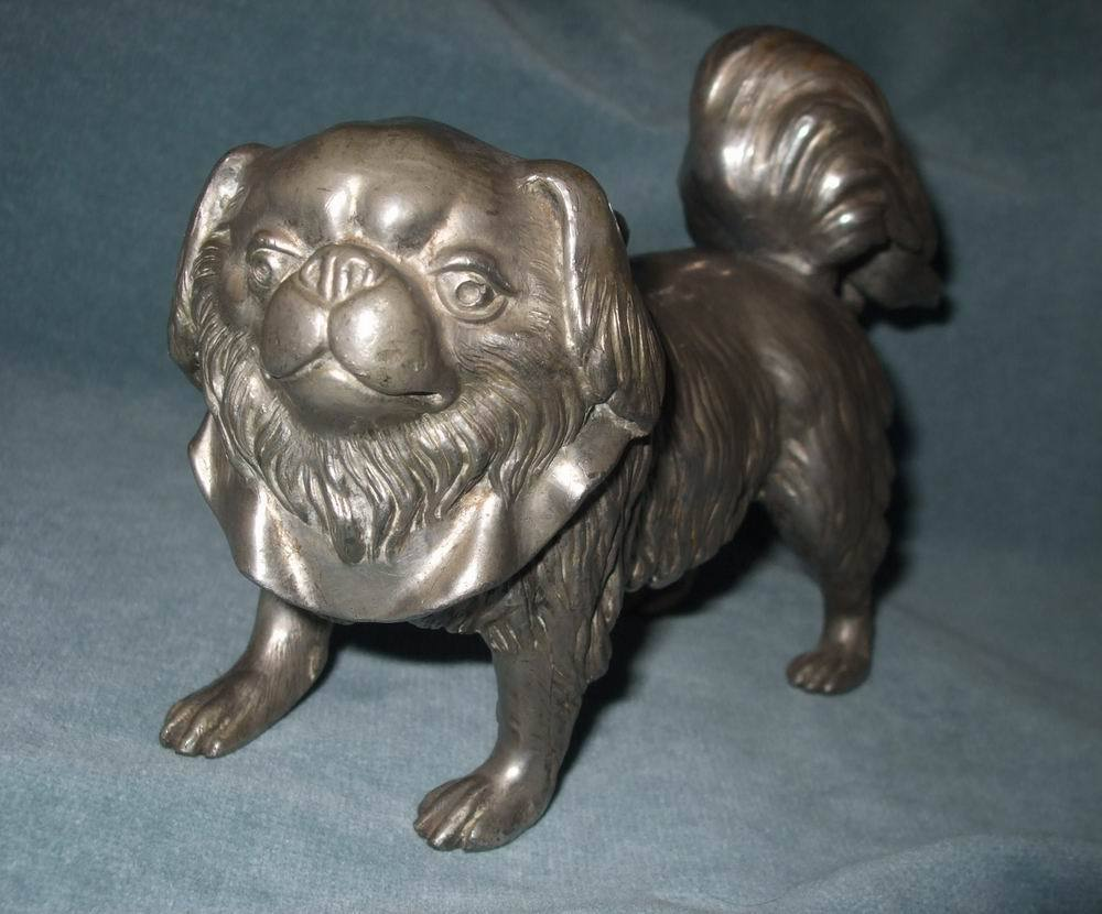 Cute White Metal Pekingese Dog Doorstop