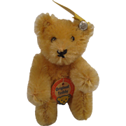 Steiff's Tiniest Fully Jointed Blonde Mohair Teddy Bear With All IDs