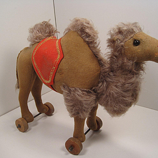 Steiff's Early Felt and Mohair Camel on Wooden Wheels