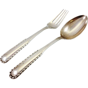 Pair of George Jensen 830 silver tablespoon and dinner fork, in Rope pattern