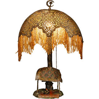 Exotic German Cold Painted Persian Rug Seller Diorama Lamp with Moon Shaped Pierced Brass Shade