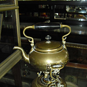 Tilting brass teapot with stand and snuffer
