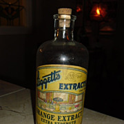 Liggett's Orange Extract bottle with Soda Fountain and Soda Post