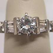 Platinum and Diamond Round Baguette Engagement Ring