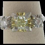Art Deco Platinum Diamond Three Stone Ring, With 0.57 Carat Natural Fancy Yellow Diamond