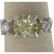 Art Deco Platinum Diamond Three Stone Ring, With 0.57 Carat Natural Fancy Yellow Diamond