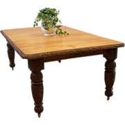 Antique English Victorian Carved Oak Dining Table.