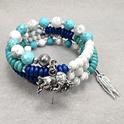 White Buffalo Woman Coil Bracelet Magnesite Turquoise White Howlite Buffalo Charm Lakota Goddess