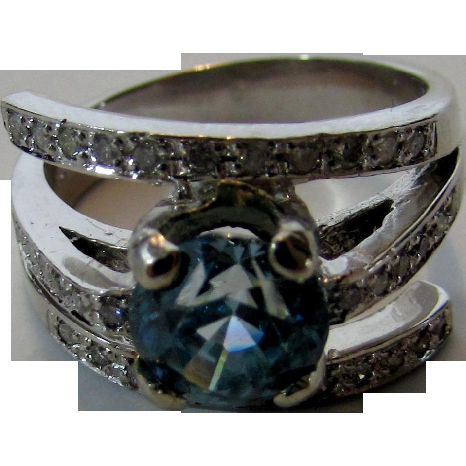 14 karat white gold ring of blue zircon and