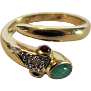 14 Karat Yellow Gold Serpent Ring With Emerald Cabochon Head and Two Sapphire Cabochon Eyes Accented by Pave Diamonds