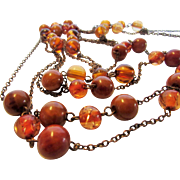 Vintage Copper Tone Three Strand Necklace With Faux Amber Beads
