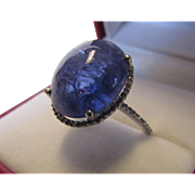 14 Karat White Gold Tanzanite Cabochon Ring With Diamond Halo