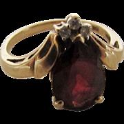 10 Karat Yellow Gold Garnet Ring With Diamond Accents