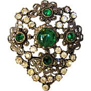 Vintage Art Glass Pin With An Art Glass Center Stone Surrounded by Green and Clear Crystals