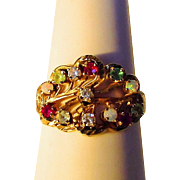 14 Karat Yellow Gold Cluster Ring With Unusual Combination of Gemstones including Diamonds, Opal, Ruby, Emerald and Moonstone