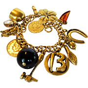 Vintage Coro Mid Century Goldtone Charm Bracelet With 12 unique Charms