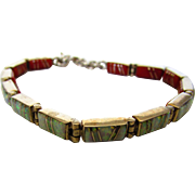 Sterling Silver Double Sided Bracelet With Inlaid Coral Reversing To Created Opal