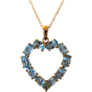 14 Karat Yellow Gold Blue Topaz Heart Pendant on a 14 Karat Yellow Gold Chain