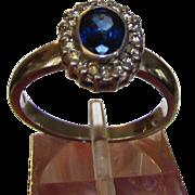 14 Karat White Gold Royal Blue Sapphire with Diamond Halo