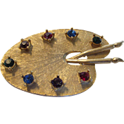 Vintage Goldtone Artist's Palette With A Variety of Gem Colored Crystals as Paints