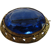 Vintage Brooch With A Blue Crystal The Color of the Finest Sapphire