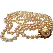 14 Karat Yellow Gold Mabe Pearl Clasp Featuring a Double Strand of Cultured Pearls