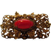 Vintage French Goldtone Filagree Pin with Trumpet Clasp With Bright Red Center Stone