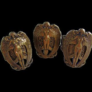 Three Art Nouveau Brass Napkins Rings